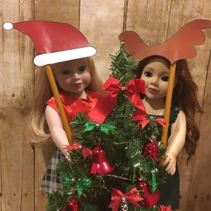 Daniela and Lily with props and Christmas tree