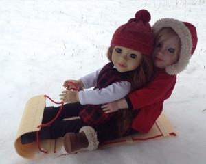 Lily and Daniela sledding