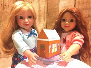 Lily and Daniela and gingerbread house